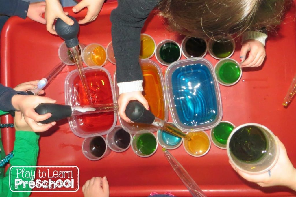 color science experiment in the sensory table