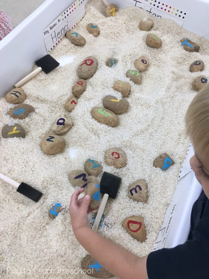 SENSORY play rice letter rocks in rice